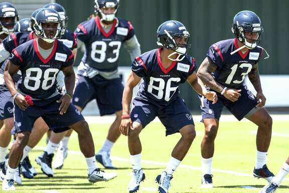 Houston Texans wide receivers Tevin Jones (88), Carlos Wiggins (86) and Braxton Miller (13) warm up during rookie mini camp at The Methodist Training Center on Friday, May 6, 2016, in Houston.