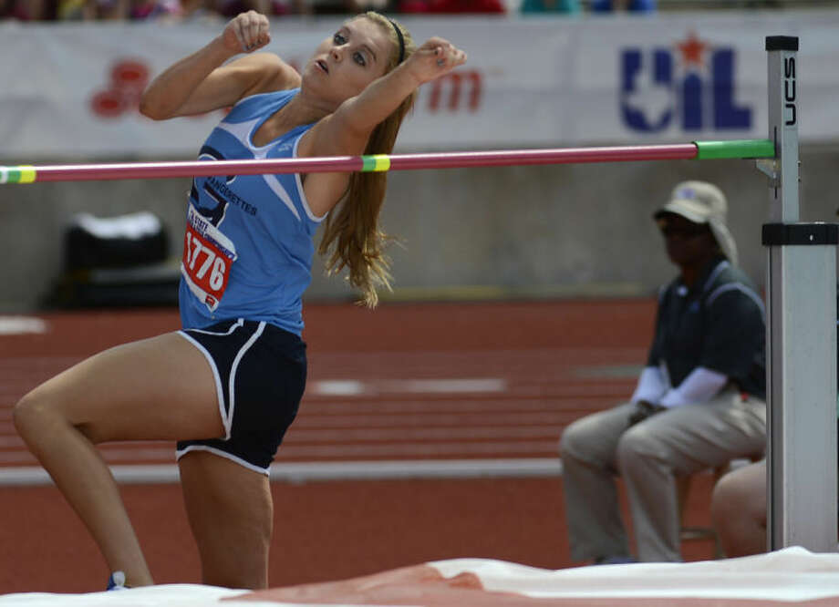 "Greenwoods Morgan McKee focus'son the high jump bar as she competes in the UIL State Track & Field meet in Austin.MgKee was making her third trip to the state meet and garnered a fifth place finish by clearing 5' 6"". Photo: Wade H Clay"