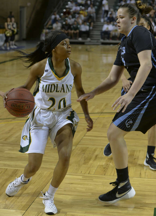 Midland College's Toni Taylor looks in the lane as Odessa College's Sadie Russell defends Monday 02-22-16 at the Chaparral Center. Tim Fischer/Reporter-Telegram Photo: Tim Fischer