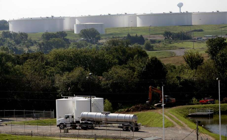 In this Aug. 28, 2007 photo, a SemCrude Energy Partners Truck unloads oil for SemCrude in Cushing, Okla. For the past seven weeks, the United States has been producing and importing an average of 1 million more barrels of oil every day than it is consuming.  Photo: Mike Simons