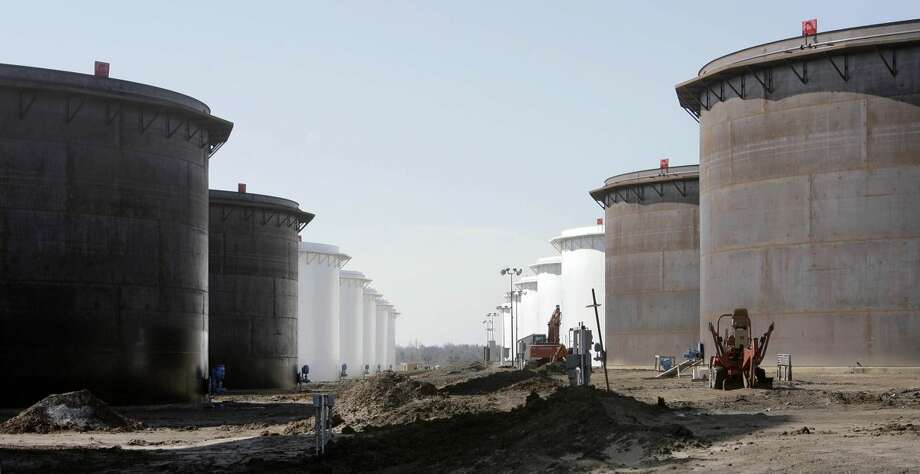 This March 13, 2012 photo shows older and newly constructed 250,000 barrel capacity oil storage tanks at the SemCrude tank farm north of Cushing, Okla. For the past seven weeks, the United States has been producing and importing an average of 1 million more barrels of oil every day than it is consuming. That extra crude is flowing into storage tanks, especially at the country's main trading hub in Cushing, pushing U.S. supplies to their highest point in at least 80 years, the Energy Department reported Wednesday, Feb. 25, 2015. (AP Photo/Tulsa World, Michael Wyke) KOTV OUT; KJRH OUT; KTUL OUT; KOKI OUT; KQCW OUT; KDOR OUT; TULSA OUT; TULSA ONLINE OUT Photo: Michael Wyke
