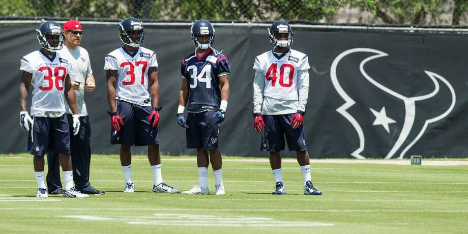 Houston Texans cornerback Richard Leonard (38), cornerback Cleveland wallace III (37), running back Tyler Ervin (34) and cornerback Duke Thomas stand on the practice field waiting to field punts during rookie mini camp at The Methodist Training Center on Friday, May 6, 2016, in Houston. Photo: Brett Coomer, Houston Chronicle / © 2016 Houston Chronicle