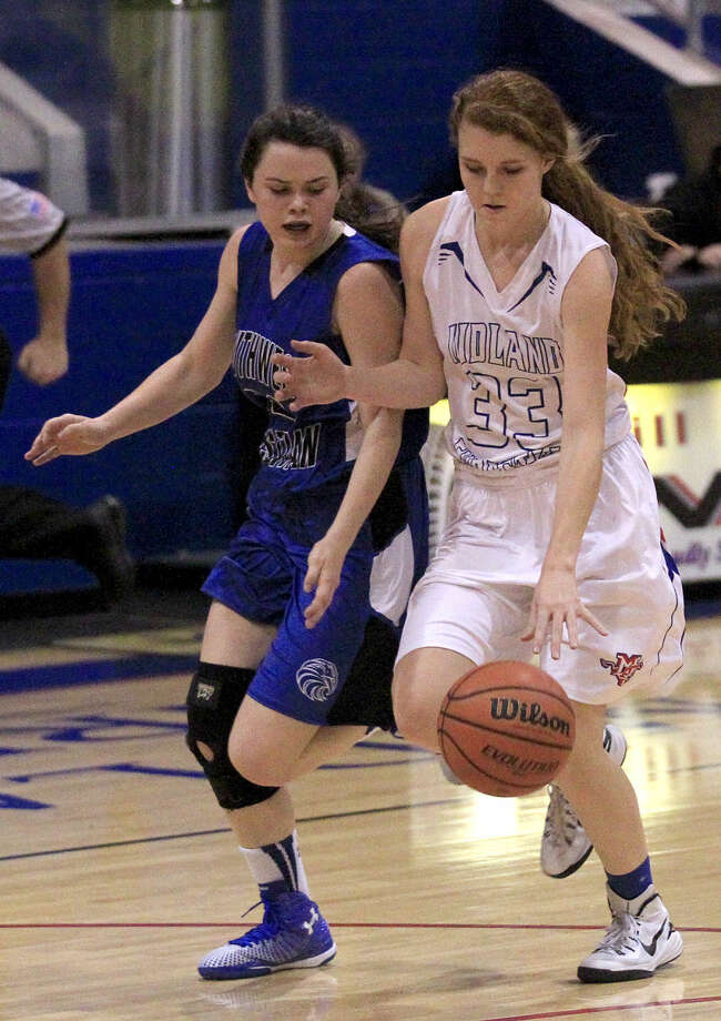 Midland Christian's Caroline Hammond (33) dribbles against Fort Worth Southwest Christian's Katie Gear (22) on Saturday, Jan. 10, 2015 at McGraw Event Center. James Durbin/Reporter-Telegram Photo: James Durbin