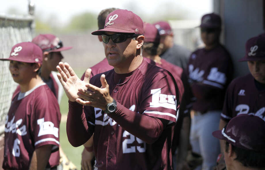 In this April 20, 2013 photo, Lee head coach Brian Roper encourages his team to keep their momentum going against Lubbock Coronado at Ernie Johnson Field. James Durbin/Reporter-Telegram Photo: JAMES DURBIN