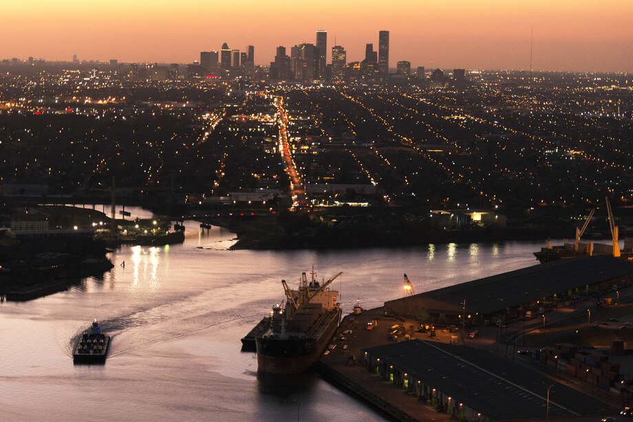 The Houston skyline is seen behind traffic on the ship channel in an aerial view on Monday, Jan. 20, 2014, in Houston. ( Smiley N. Pool / Houston Chronicle ) Photo: Smiley N. Pool