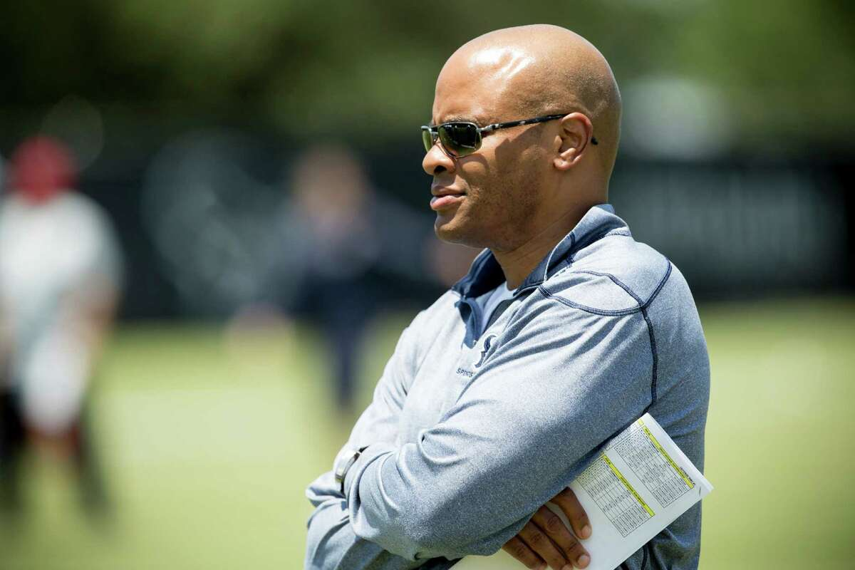 Houston Texans general manager Rick Smith, watching the team at rookie minicamp, will have his contract extended through 2020. Click through the gallery to see where Smith ranked in last year's NFL GM rankings by the Chronicle.