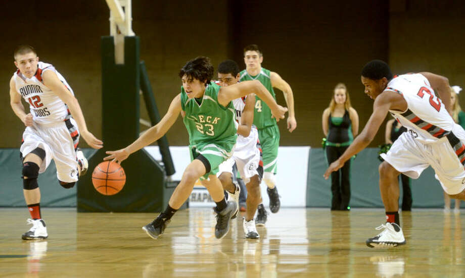 In this Feb. 28, 2014 photo, Breckenridge's Alain Franco (23) takes the ball down the court against Brownfield  in the Region I-2A boys basketball regional semifinal at Chaparral Center. James Durbin/Reporter-Telegram Photo: JAMES DURBIN
