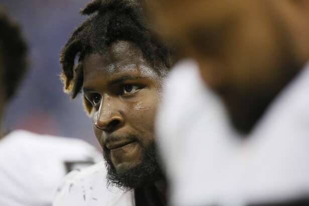 Oakland Raiders defensive end Mario Edwards Jr., is seen in the bench area during the second half of an NFL football game against the Detroit Lions, Sunday, Nov. 22, 2015, in Detroit. (AP Photo/Duane Burleson)
