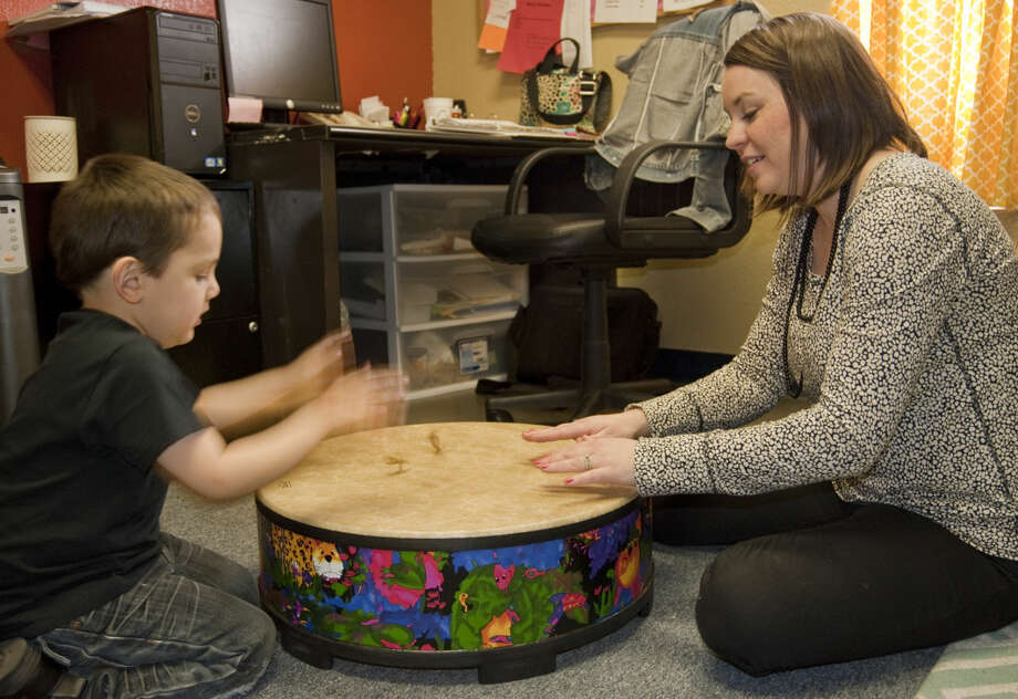 Kayla Minchew uses music and song with Demetrio Baeza on Tuesday as part of his therapy to learn and use new words. Tim Fischer\Reporter-Telegram Photo: Tim Fischer