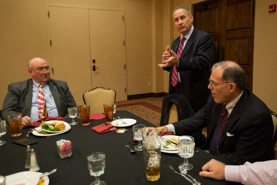 Steve Green (middle) chairman of the Museum of the Bible board of directors and president of the Hobby Lobby, and Cary Summers (left), president of the Museum of the Bible speak to guests including C.R. �Dick' Saulsbury regarding their Museum of the Bible being constructed in Washington D.C. Photo: Courtney Sacco