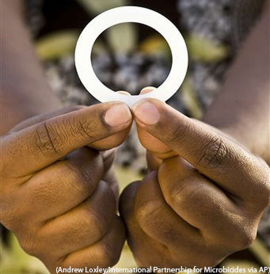 This photo provided by the International Partnership for Microbicides shows a ring that is coated with an anti-AIDS drug designed for women to insert into the vagina once a month to reduce the risk of HIV infection. Researchers say women who inserted a vaginal ring coated with an anti-AIDS drug once a month were partially protected against HIV infection. Two large studies in Africa found the effect was modest, reducing overall HIV infection by about a third. But surprisingly, the ring worked far better in women 25 and older, leaving researchers wondering if younger women who got little to no benefit simply didn't use the device properly. (Andrew Loxley/International Partnership for Microbicides via AP) Photo: Andrew Loxley