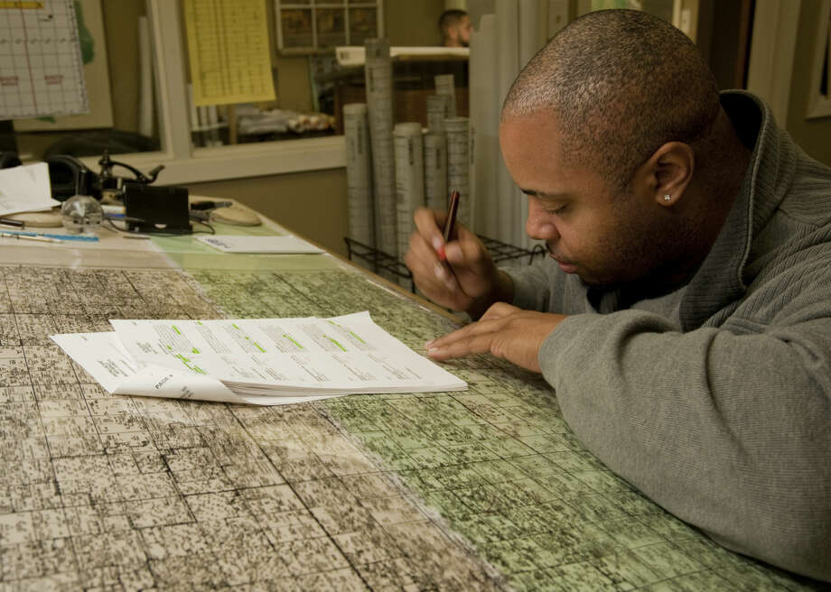 Cedric Johnson works to hand update the lease ownership and wells on a New Mexico map of the Permian Basin Area Wednesday, 3-4-15, at Midland Maps. Tim Fischer\Reporter-Telegram Photo: Tim Fischer