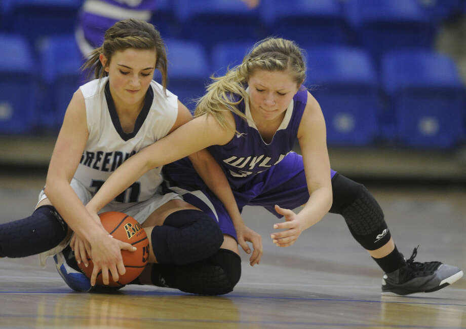Midland Greenwood's Caity Payne (10) fights for a loose ball with Wylie's Skylar Williams (32) during the third quarter of Greenwood's 52-32 loss in the Region I-4A championship game on Saturday, Feb. 27, 2016, at the Rip Griffin Center in Lubbock. (Photo by Tommy Metthe/Abilene Reporter-News) Photo: Tommy Metthe