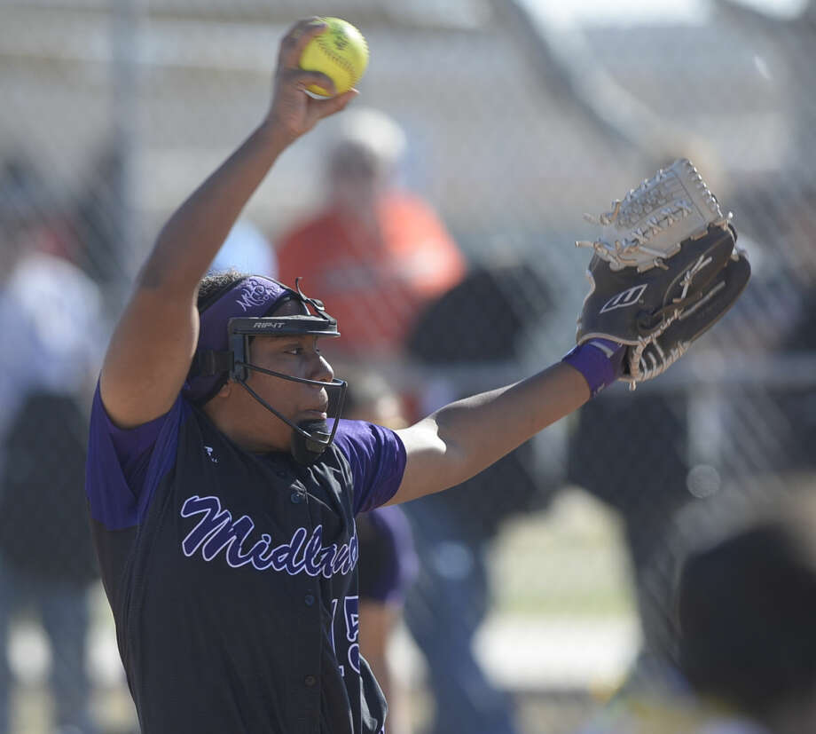 Midland's Deandra Allen pitches against Andrews in a West Texas Softball Classic match Saturday, Feb. 27, 2016, at Freddie Ezell Softball Complex. James Durbin/Reporter-Telegram