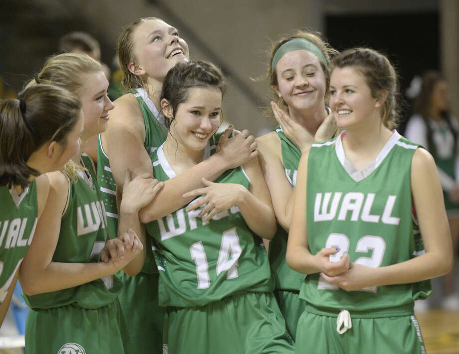 Wall girls basketball players celebrate a win against Idalou in the UIL Region I-3A championship game Saturday, Feb. 27, 2016, at Chaparral Center. James Durbin/Reporter-Telegram Photo: James Durbin