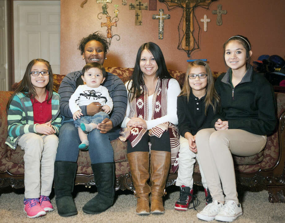 From left, Abbey Ochoa, 9; Vzysha Bell, 17; A.J. Ochoa, 10 months; Crystal Ochoa,; Avrey Ochoa, 7; and Awbrey Ochoa, 13, pose Feb. 5 for a family picture. James Durbin/Reporter-Telegram Photo: James Durbin