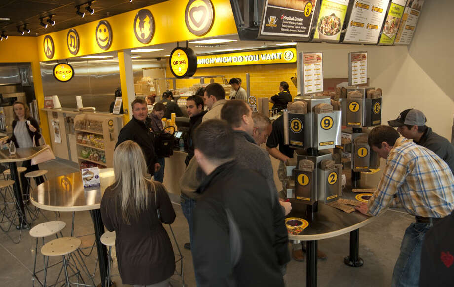 Patrons fill out their sandwich requests Monday, 03-09-15, during the first day Which Wich opens. Tim Fischer\Reporter-Telegram Photo: Tim Fischer