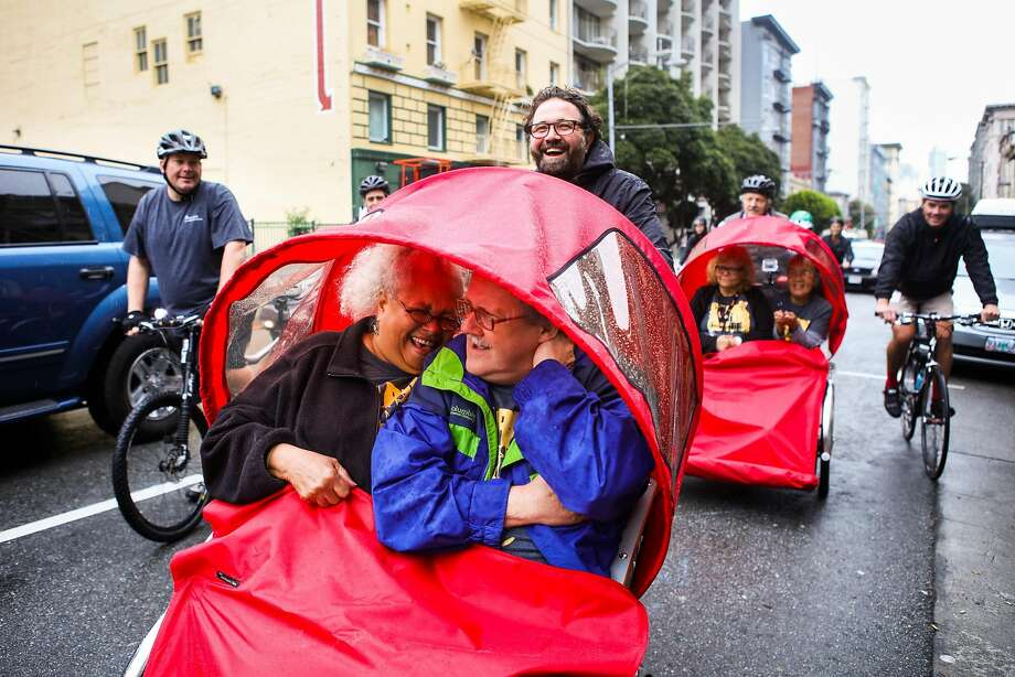 Seniors Diane Evans (front, left) and Garrett Swing (front, right), laugh as they get a ride from Zendesk CEO Mikkel Svanel (back, center) in a tricycle rickshaw, in San Francisco, California, on Friday, May 6, 2016. Photo: Gabrielle Lurie, Special To The Chronicle