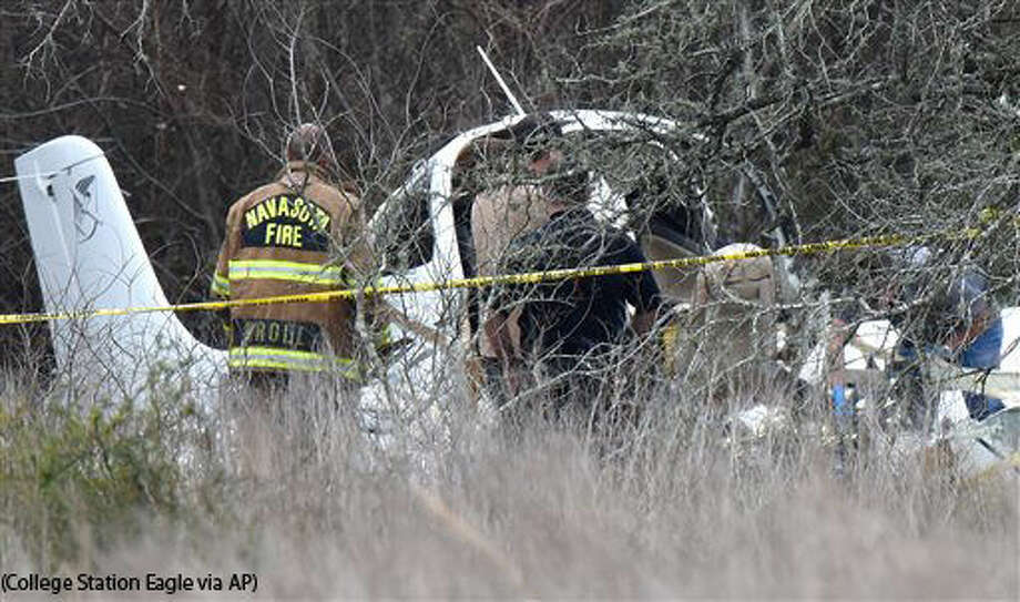 FAA officials and Navasota, Texas rescue personnel look over the wreckage of a single-engine airplane Sunday, Feb. 28, 2016 that crashed near the Navasota Municipal Airport killing the 4 passengers aboard. /College Station Eagle via AP) MANDATORY CREDIT Photo: Dave McDermand/The Eagle
