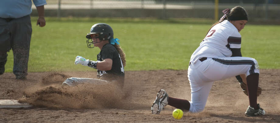 Permian's Kali Holcomb safely slides into second as Lee's Emily Nunez looses the ball Tuesday, 03-10-15, at Gene Smith Field. Tim Fischer\Reporter-Telegram Photo: Tim Fischer
