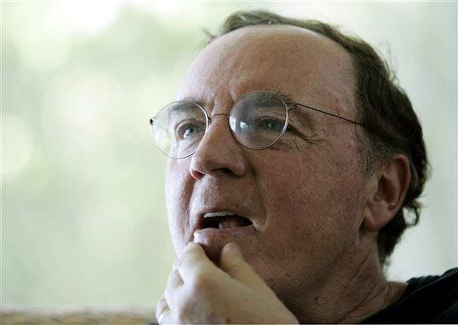 FILE - In this May 3, 2006, file photo, author James Patterson contemplates a question during an interview at his home overlooking the Intracoastal Waterway in Palm Beach, Fla. Having handed out more than $1 million to help independent bookstores, James Patterson is now sharing his wealth with public school libraries. The best-selling author announced Monday, March 9, 2015, that he was donating $1.25 million through a grant program administered with Scholastic Reading Club. (AP Photo/Wilfredo Lee, File) Photo: Wilfredo Lee