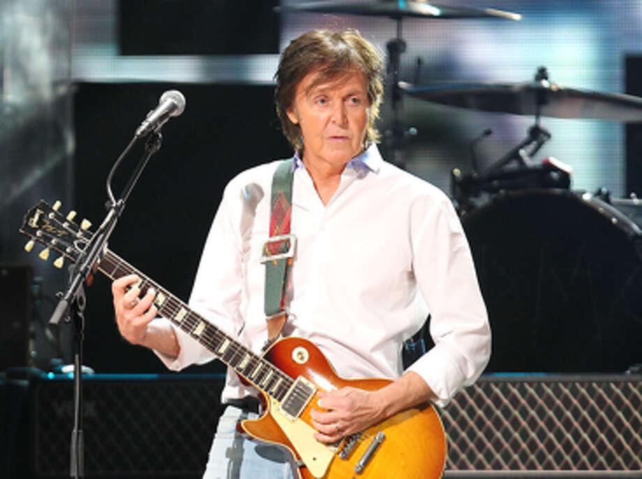 FILE - This Dec. 12, 2012 file image released by Starpix shows Paul McCartney at the 12-12-12 The Concert for Sandy Relief at Madison Square Garden in New York. McCartney is adding his voice to Tony Bennett's campaign against gun violence. The former Beatle recorded a voice message that's part of a text-to-call operation Wednesday, April 17, 2013, for Bennett's Voices Against Violence campaign. McCartney and others are encouraging Americans to send a text, which will lead to the singer's message and connect the caller to their local senate office after proving their zip code. (AP Photo/Starpix, Dave Allocca, file) Photo: Dave Allocca / STARPIX