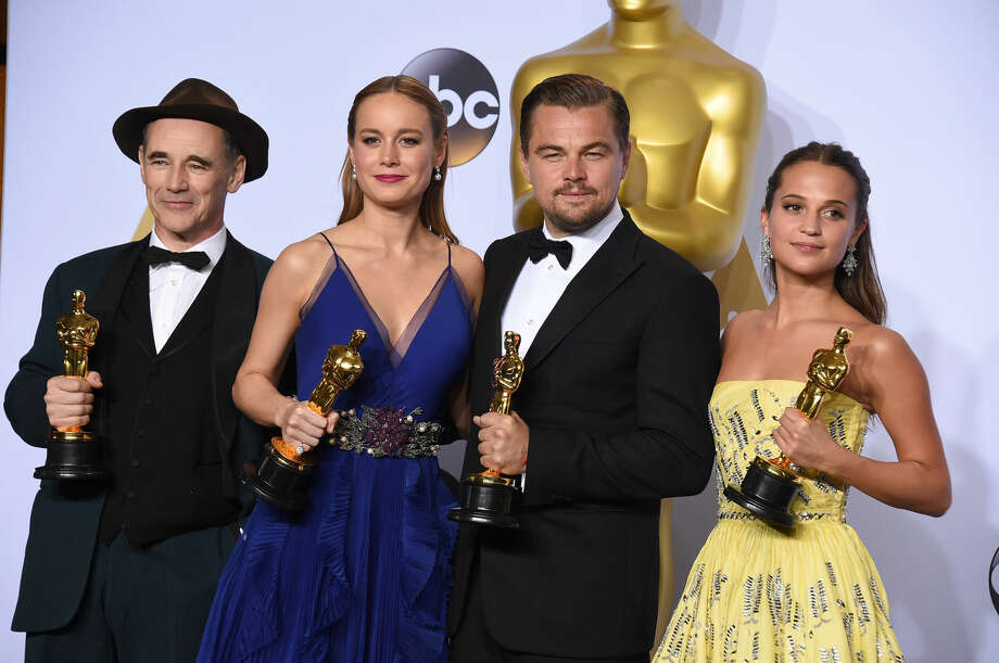 "Mark Rylance, winner of the award for best actor in a supporting role for ""Bridge of Spies,"" from left, Brie Larson, winner of the award for best actress in a leading role for ""Room"", Leonardo DiCaprio, winner of the award for best actor in a leading role for ""The Revenant"", and Alicia Vikander, winner of the award for best actress in a supporting role for ""The Danish Girl"" pose in the press room at the Oscars on Sunday, Feb. 28, 2016, at the Dolby Theatre in Los Angeles. (Photo by Jordan Strauss/Invision/AP) Photo: Jordan Strauss / AP"