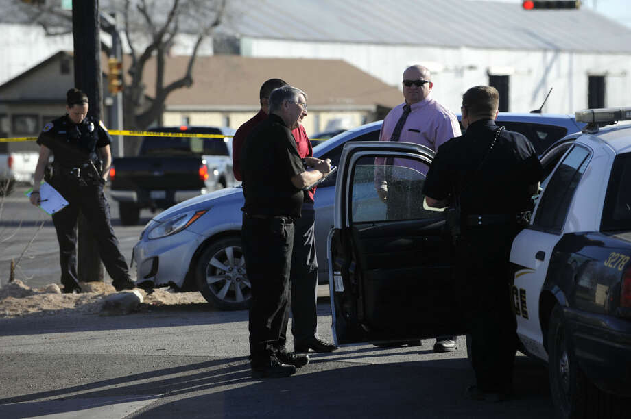 Odessa, Texas police investigate the scene where OPD Officer Raymond Feril was stabbed following a foot pursuit of Russell Huertas Thursday morning, March 12, 2015 along 23rd Street near Andrews Highway in Odessa. Officer Feril was transported to Medical Center Hospital with non-life-threatening injuries. Huertas was shot with a stun gun by another officer who arrived on the scene, and was taken into custody. (AP Photo/Odessa American, Mark Sterkel) Photo: Mark Sterkel