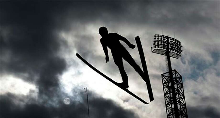 France's Sebastian Lacroix soars through the air during a men's nordic combined training session in the ski jumping stadium at the 2014 Winter Olympics, Monday, Feb. 10, 2014, in Krasnaya Polyana, Russia. (AP Photo/Matthias Schrader) Photo: Matthias Schrader / AP