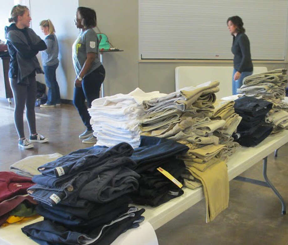 More than 400 school uniforms are stacked and ready to be boxed for delivery to local schools. Photo: Courtesy Photo