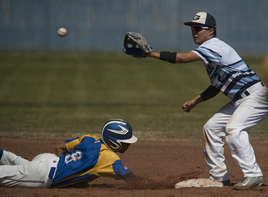 Reagan County's Alex Chavez dives back to second on a hit and catch as Greenwood's Victor Urias reaches for the throw Thursday, 3-12-15, diuring a game at Greenwood in the West Texas Classic Tournament. Tim Fischer\Reporter-Telegram Photo: Tim Fischer
