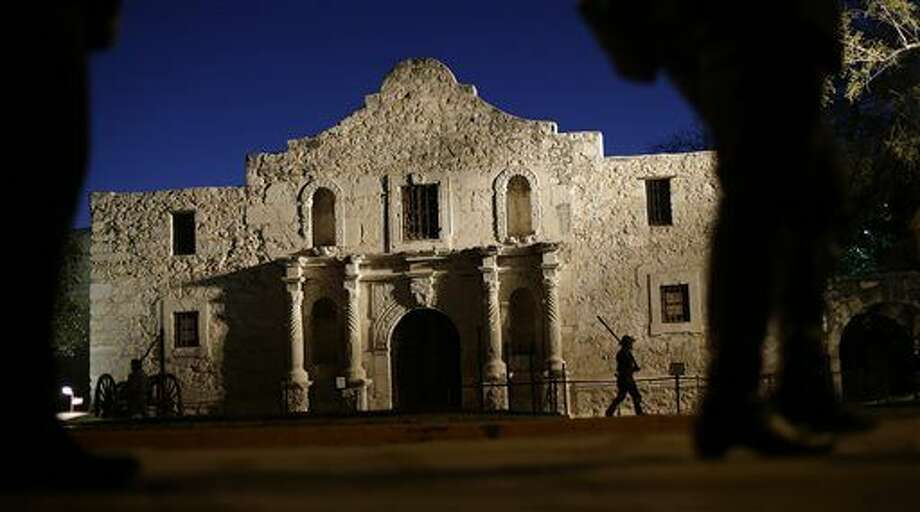 File - In this March 6, 2013, file photo, Dan Phillips, a member of the San Antonio Living History Association, patrols the Alamo during a pre-dawn memorial ceremony to remember the 1836 Battle of the Alamo and those who fell on both sides, in San Antonio. Texas is taking over management of the Alamo, ending the Daughters of the Texas Republic's 110-year management of the site, according to a joint statement issued Thursday, March 12, 2015. (AP Photo/Eric Gay, File) Photo: Eric Gay