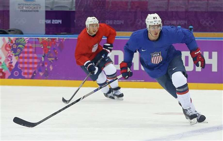 USA defenseman Ryan McDonagh, right, and forward Ryan Callahan run through a drill during a training session at the 2014 Winter Olympics, Monday, Feb. 10, 2014, in Sochi, Russia. (AP Photo/Julie Jacobson) Photo: Julie Jacobson / AP