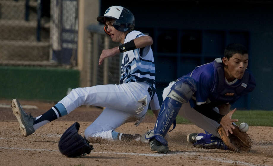 Greenwood's Kade Cotton safely slides across home as Alpine catcher, Danny Hernandez gets the ball too late off a hit Saturday, 3-14-15, at Security Bank Ballpark. Tim Fischer\Reporter-Telegram Photo: Tim Fischer