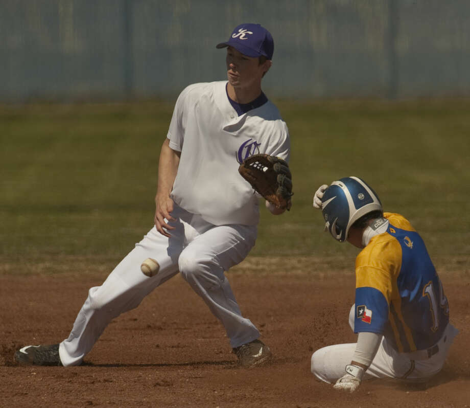 Reagan County's Johnny Gallegos safely steals second as Midland Classical's Josh Rabe can't handle the throw Thursday, 3-12-15, diuring a game at Greenwood in the West Texas Classic Tournament. Tim Fischer\Reporter-Telegram Photo: Tim Fischer