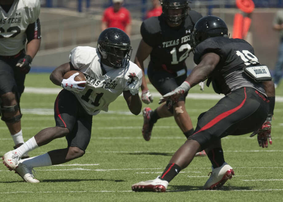 Texas Tech's Jakeem Grant cuts back to try to get away from a defender Saturday during Texas Tech's scrimmage at Grande Communications Stadium in this March 29, 2014 file photo. Tim Fischer\Reporter-Telegram Photo: Tim Fischer