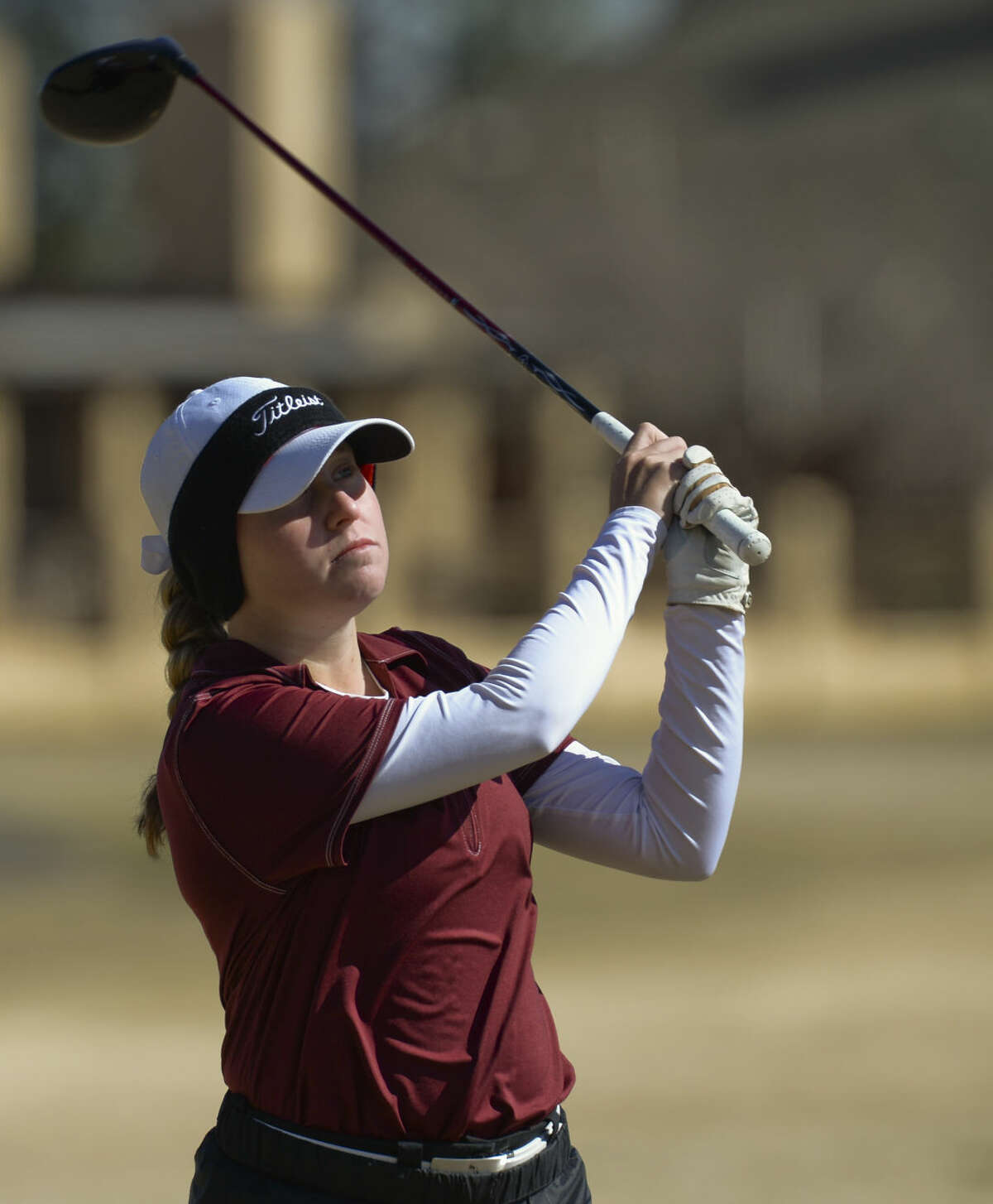 Lee's Rebecca Reed watches her shot Friday 02-26-16 at the Girls Tall City Golf Invitational. Tim Fischer/Reporter-Telegram