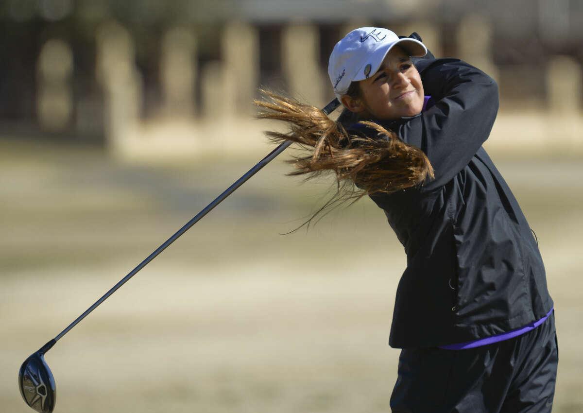 Midland High's Faith DeLaGarza watches her shot Friday 02-26-16 at the Girls Tall City Golf Invitational. Tim Fischer/Reporter-Telegram