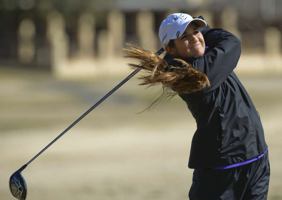 Midland High's Faith DeLaGarza watches her shot Friday 02-26-16 at the Girls Tall City Golf Invitational. Tim Fischer/Reporter-Telegram Photo: Tim Fischer