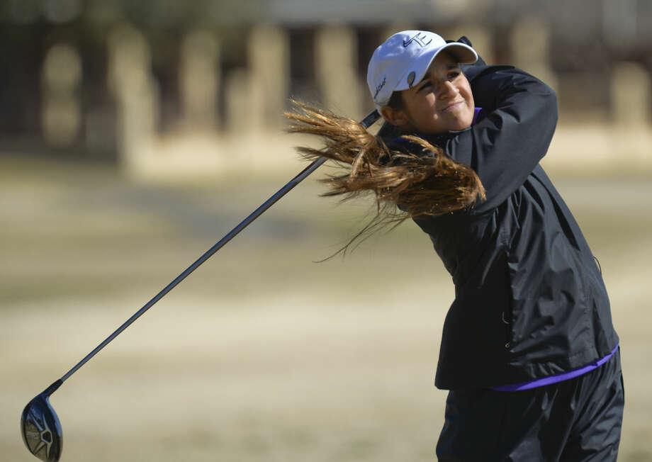 Midland High's Faith DeLaGarza watches her shot Friday 02-26-16 at the Girls Tall City Golf Invitational. Tim Fischer/Reporter-Telegram Photo: Tim Fischer