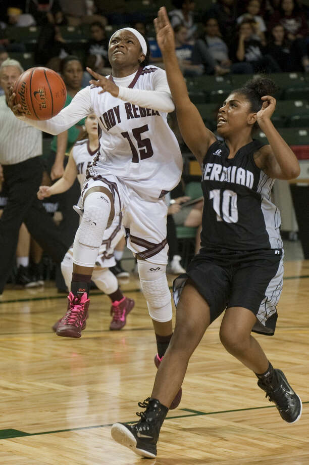 Lee's Bri'An Washington drives to the basket as Permian's Ke'Avionni Ranzy defends Tuesday evening, 2-3-15, at the Chaparral Center. Tim Fischer\Reporter-Telegram Photo: Tim Fischer