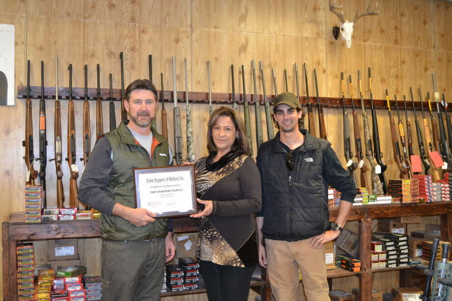 Carolyn Hatcher, center, Midland Crime Stoppers board president, recently presented a certificate of appreciation to Collier Pennington, left, owner of TMP Hunters Supply, and Dane Bowden, also with TMP, for supplying the guns for the nonprofit's 40 Guns in 40 Days fundraiser. Photo: Courtesy Photo