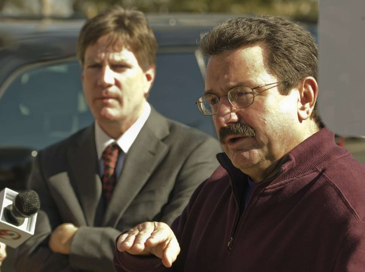 Bob Pottroff and Kevin Glasheen, lawyers hired by some of the people injured in the train accident last Thursday, talk with media Monday morning outside Midland County Courthouse. Tim Fischer\Reporter-Telegram