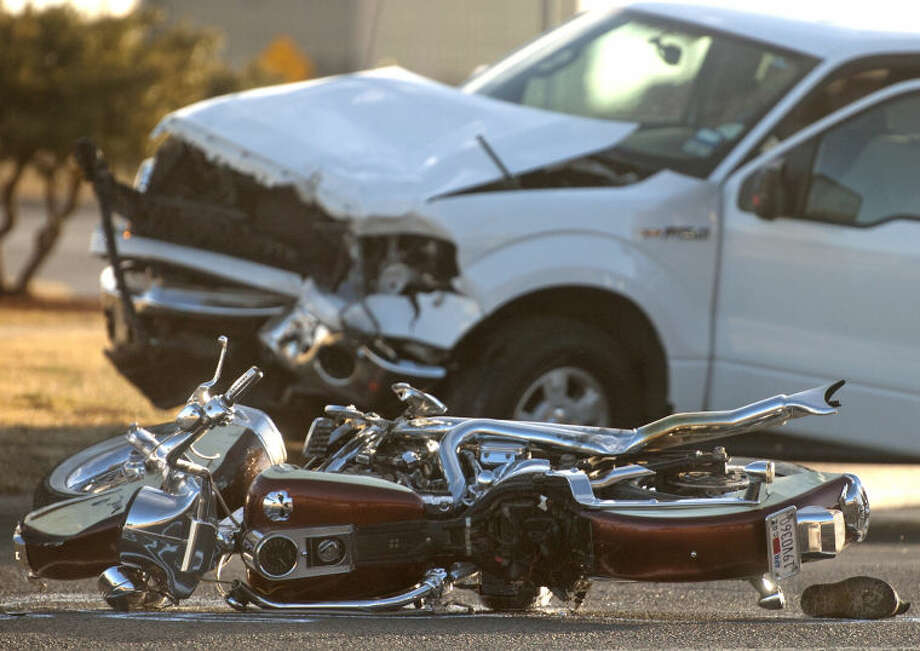 (File Photo) A motorcycle collided with a truck Tuesday near the intersection of North Big Spring and Loop 250, resulting in one fatality. According to Midland Police the driver of the motorcycle was pronounced dead at the scene and was not wearing a helmet. James Durbin/Reporter-Telegram Photo: JAMES DURBIN