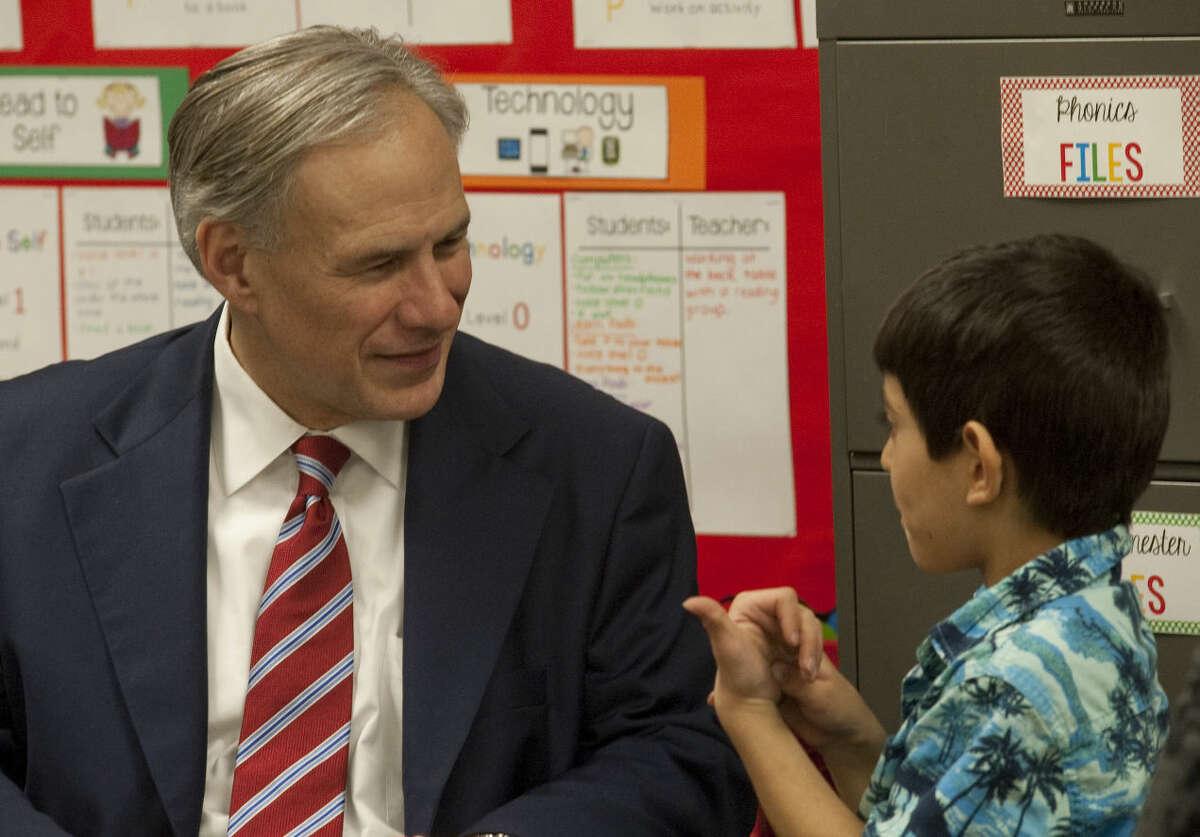 Governor Greg Abbott gets some first hand information from kindergartener Lorenzo Aguilar Tuesday, March 3, 2015, while visiting Emerson Elementary. Tim Fischer\Reporter-Telegram
