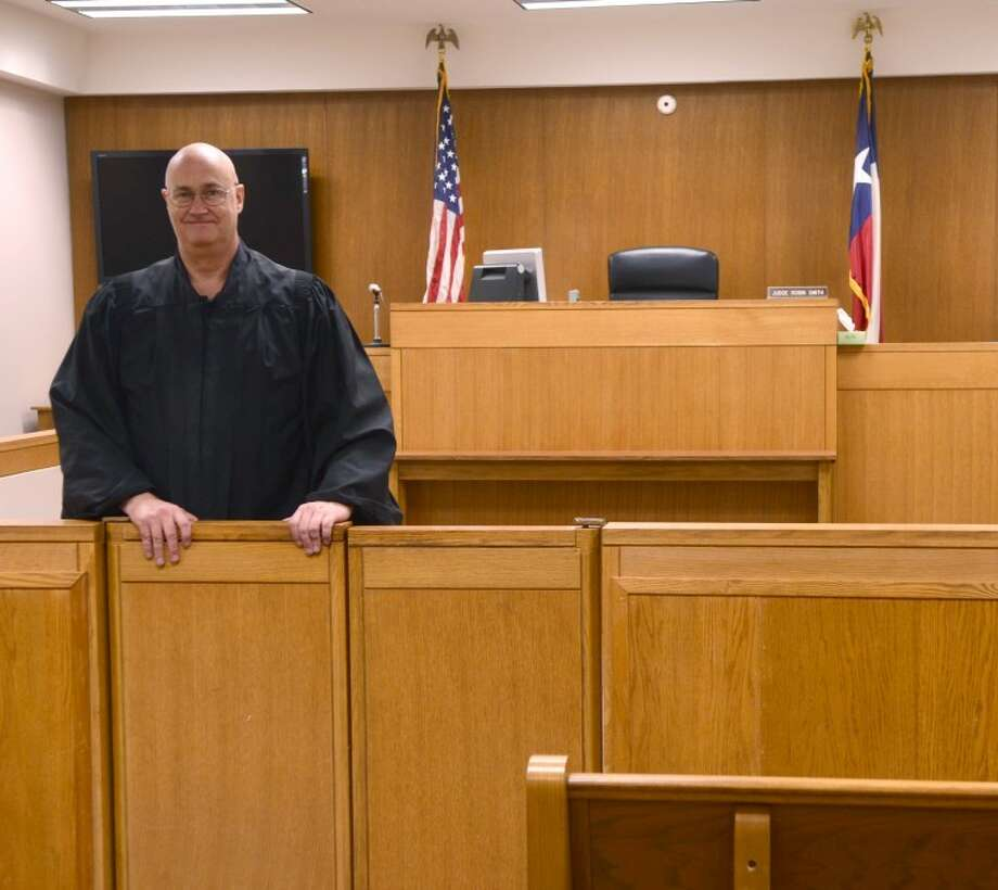Judge Robin Smith stands in his courtroom in the Municipal Courthouse on Illinois. Midland City Council is looking for a larger building to move the court into. Photo by Tim Fischer/Midland Reporter-Telegram