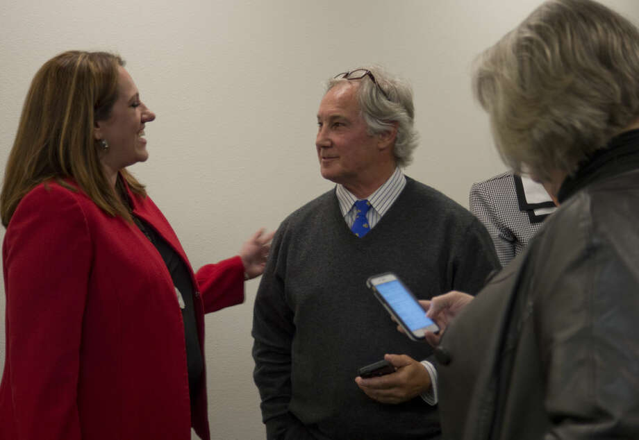 Will Lundy congratulates Laura Nodolf Tuesday 03-01-16 after early voting results were released at the Midland County Annex building as retiring DA Teresa Clingan, right, looks at other early voting results. Tim Fischer\Reporter-Telegram Photo: Tim Fischer