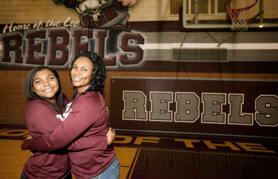 Lee High girls basketball head coach Monica Ramirez and her daughter Kyra Lewis, a sophomore on the team, pose for a photo Saturday in the Lee High gym. James Durbin/Reporter-Telegram Photo: JAMES DURBIN
