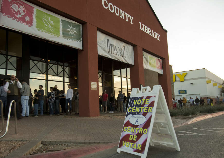 Voters wait in line outside the Centennial Library to cast their ballot. Tim Fischer\Reporter-Telegram