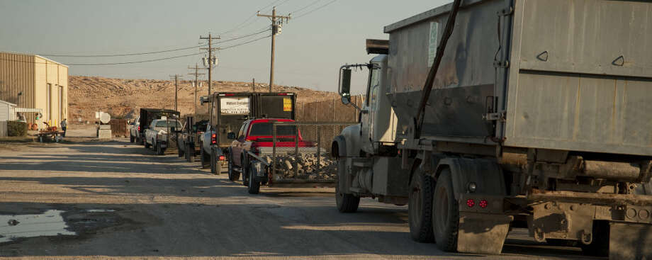 Trucks line up at the City Landfill Friday, 3-13-15, morning as they wait to be weighed before entering. Tim Fischer\Reporter-Telegram Photo: Tim Fischer